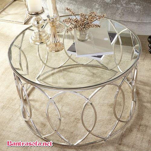 bàn trà mặt kính khung sắt hoa văn