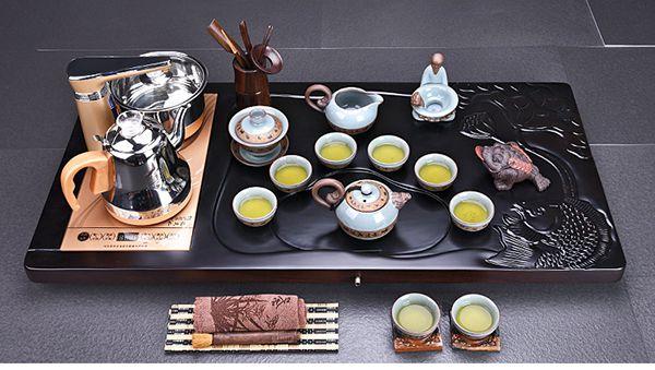 Bàn trà điện khắc cá chép hoa sen.