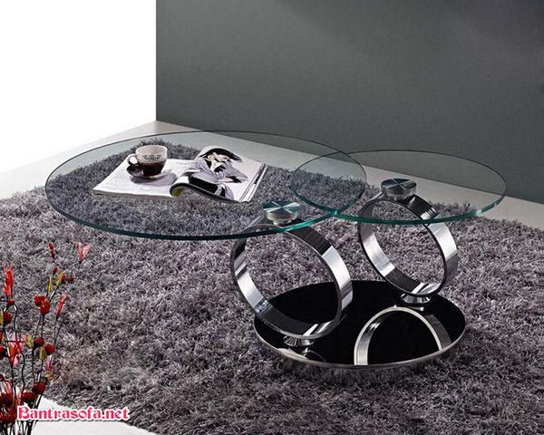 bàn trà xoay mặt kính chân inox